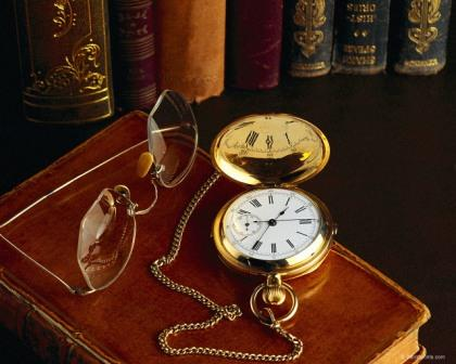 pocketwatch and books